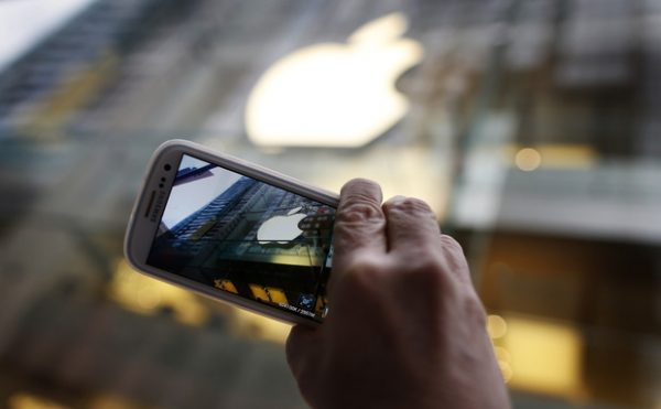 Passerby photographs Apple store logo with his Samsung Galaxy phone in central Sydney